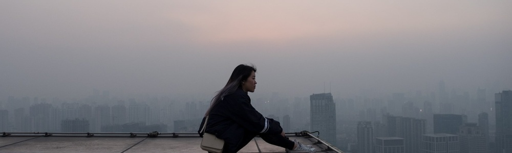 sitting alone on a rooftop