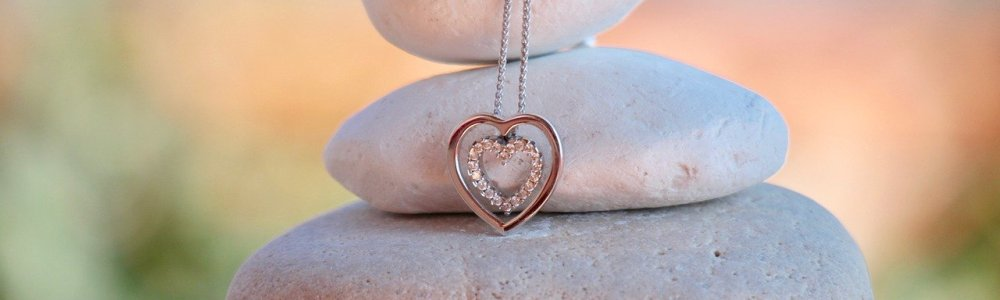 heart necklace on stones
